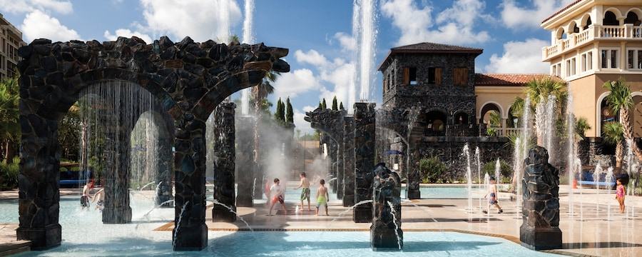 Kids splash around in a water play area at Four Seasons Resort Orlando at Walt Disney World Resort