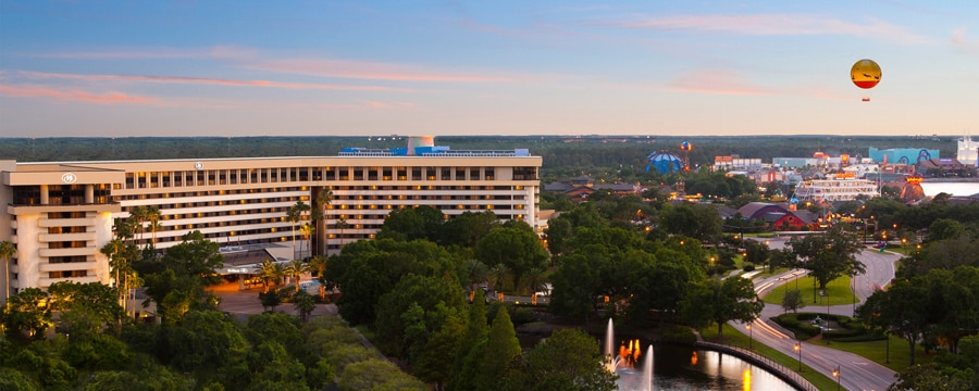 Trees near a hotel, a street, a lake and Disney Springs