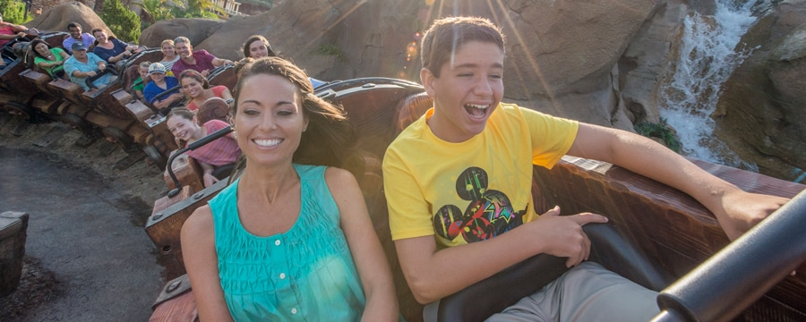 A family laughing while walking away from The Twilight Zone Tower of Terror in Disney's Hollywood Studios