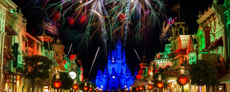 Dazzling fireworks over Cinderella Castle framed by Main Street U.S.A. lit up at night