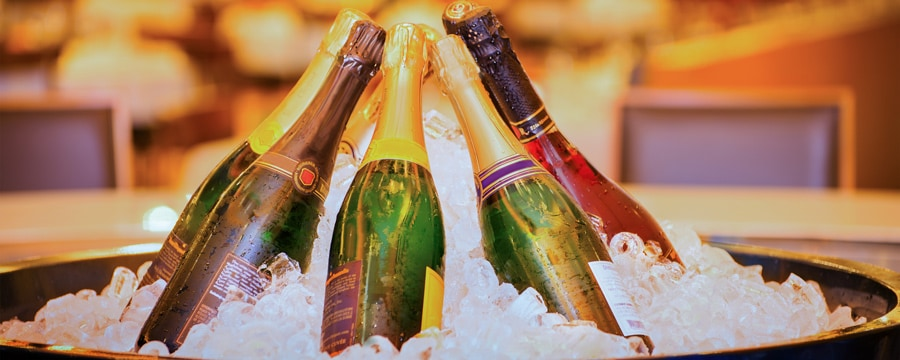 7 bottles of Champagne sit in a bucket of ice