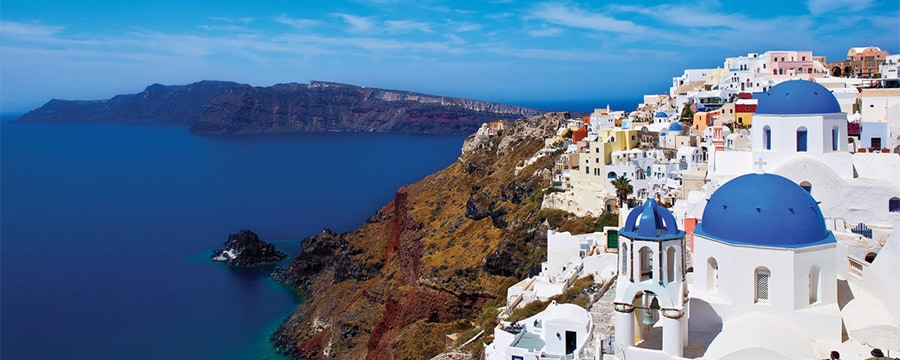 Blue-domed buildings on the coastline of Santorini, Greece