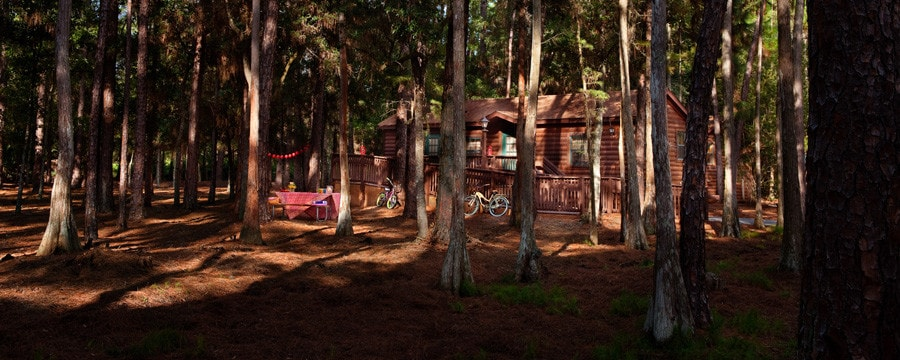 A cabin and picnic table at The Cabins at Disney's Fort Wilderness Resort in Florida