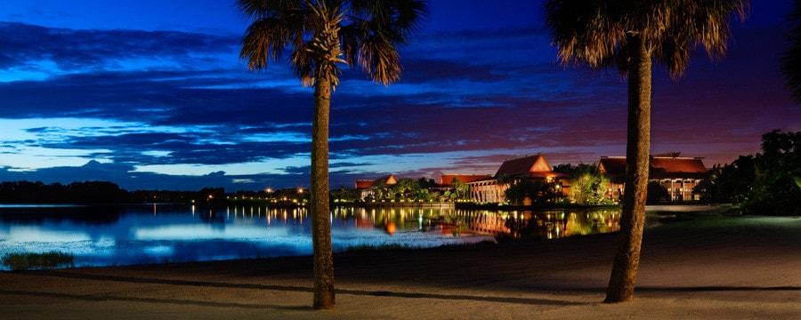 Disney's Polynesian Village Resort and Seven Seas Lagoon at night