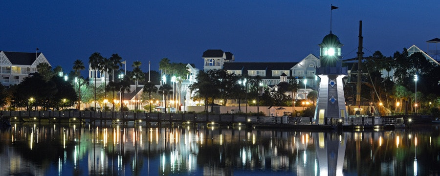 The building exterior and waterfront of Disney's Yacht Club Resort in Florida