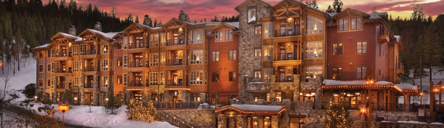 The illuminated exterior of Northstar Lodge by Welk Resorts at sunset