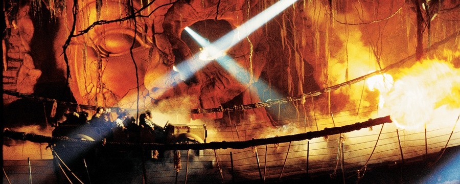 A large, golden glowing mural of the deity Mara at the Indiana Jones Adventure attraction