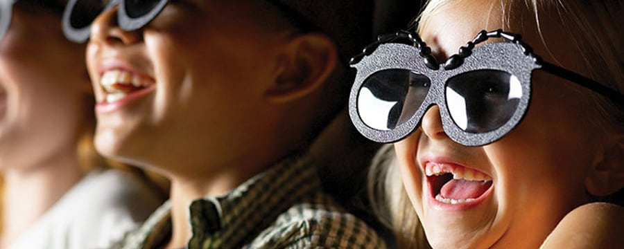 Girl watching It's Tough to Be a Bug wearing 3D Glasses