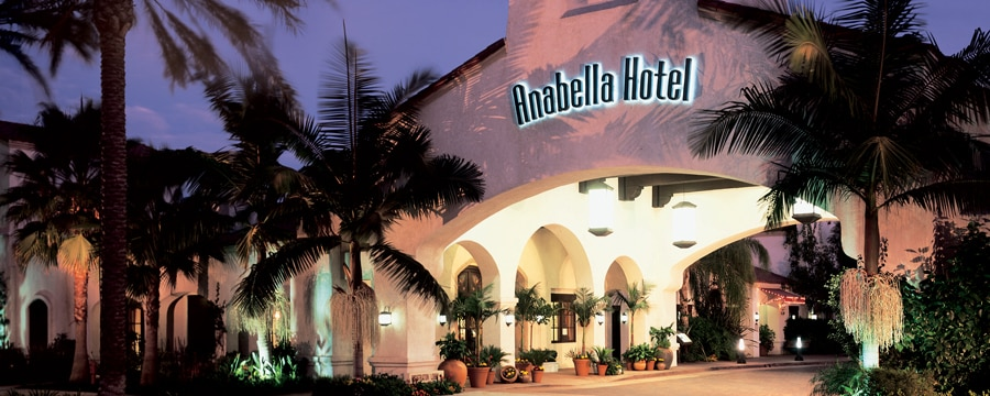 Palm trees leading to the entrance to the Mission-style Anabella Hotel