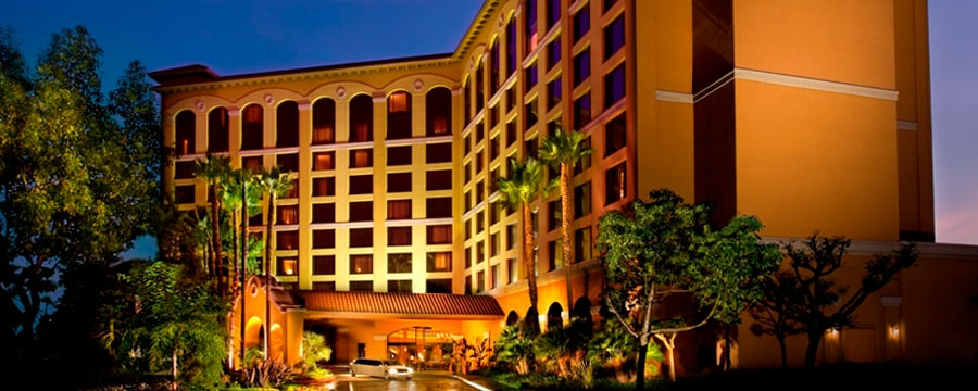 The entrance to the 9-floor Wyndham Hotel Anaheim lit up at night
