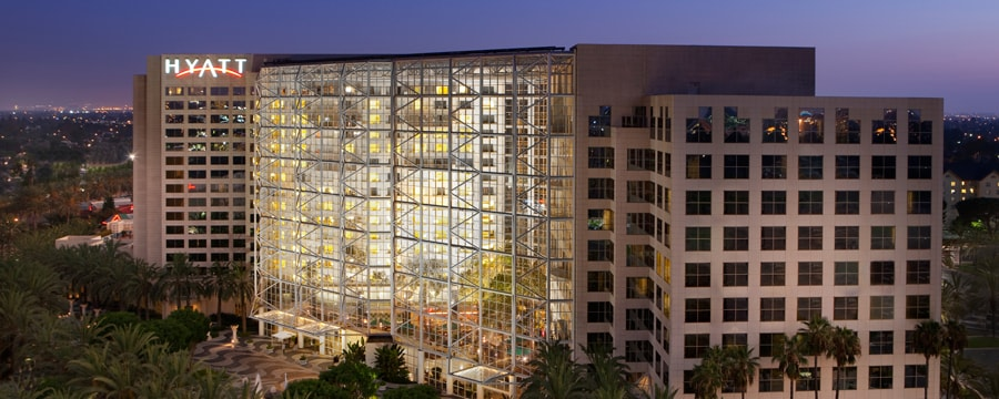 The modern structure of the Hyatt Regency Orange County lit up at night