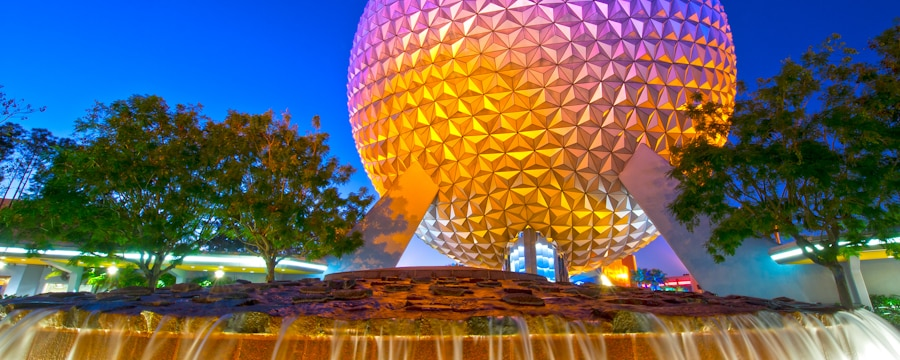 Monorail gliding by Leave a Legacy granite monuments and Spaceship Earth at dawn