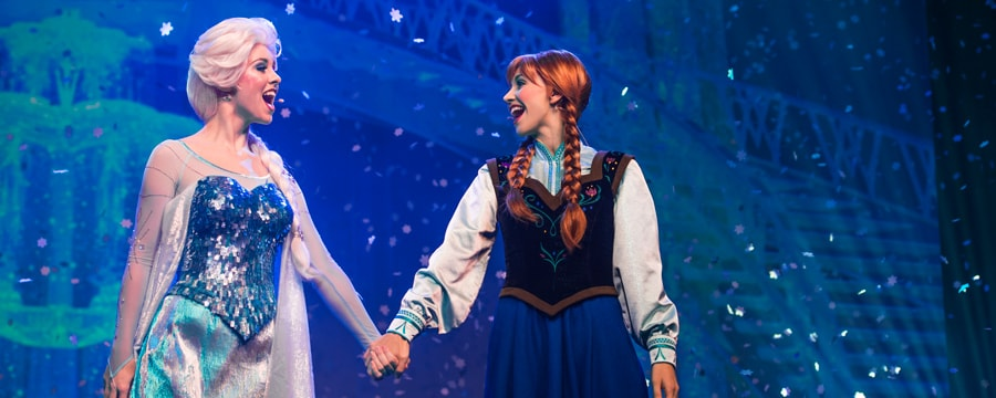 Princess Anna and Queen Elsa sing to each other during For the First Time in Forever: A Frozen Sing-Along Celebration