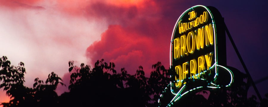 The neon sign for The Hollywood Brown Derby at dusk