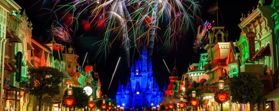 Dazzling fireworks over Cinderella Castle framed by Main Street U.S.A. lit up at night