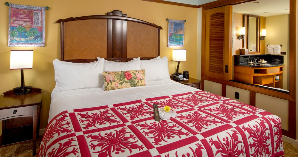 two bedroom. Complimentary chocolates on the master king bed  which looks in bathroom through a Two Bedroom Villa Aulani Hawaii Resort Spa