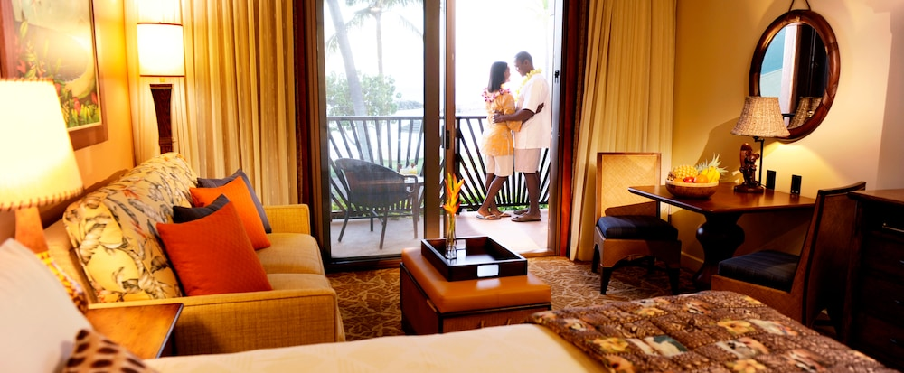 A Embraces On The Balcony Of Their Hotel Room Featuring Large Sitting Area And