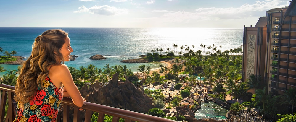 A Woman On Balcony Overlooking Aulani And The Beach
