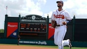 A baseball player wearing an Atlanta Braves jersey