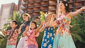 A family learns Hawaiian dancing