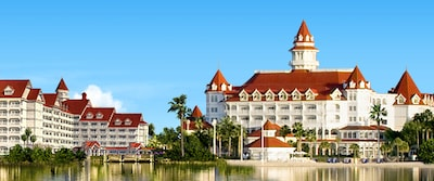 The 3 towers of Disneys Grand Floridian Resort and Spa are right next to a tranquil lake